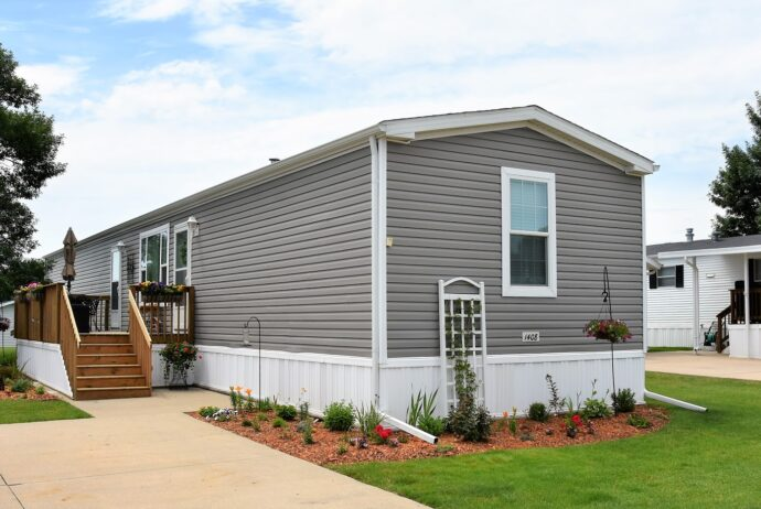 gray single wide mobile home with front steps