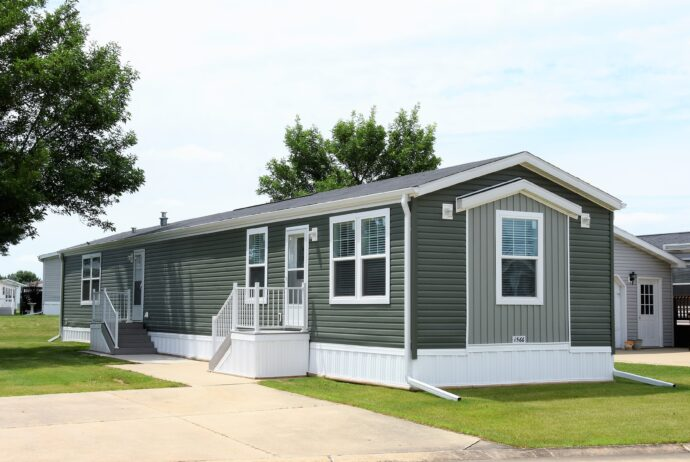 gray with white skirt single wide mobile home