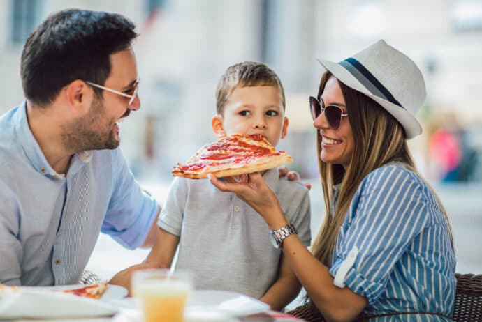 Happy family eating in a restaurant